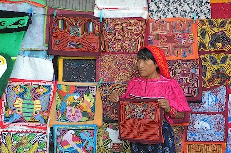 This Cuna woman displays the Panamanian tribe's molas -- layers of colored cloth sewn together with designs cut out of the layers.