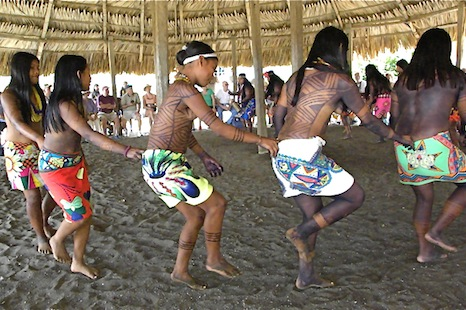 Young girls and teenagers of the Embera tribe dance for tourists visiting their village on the southeastern coast of Panama.