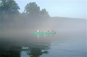 Morning mist obscures anglers on the White River, Arkansas.