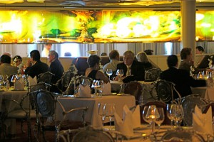 Passengers 'dress' for dinner and enjoy crystal and fine china in this restaurant aboard a 1,900 passenger ship.