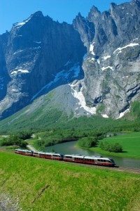 The Rauma train passes by the mighty Trollveggen, which juts 1,000 feet up. © Leif J Olestad.